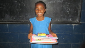 Wilma smiles with her school supplies