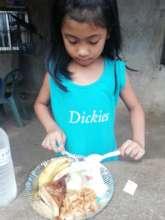 Little girl enjoying her meal