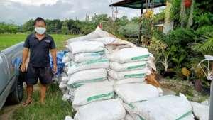 Farmer in Thailand adding biochar to crops