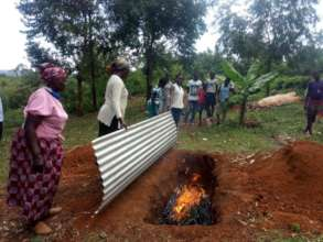 Kenya biochar training with trench & roofing sheet