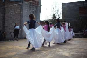 Pandemic remote dance class for 50 girls in ARG