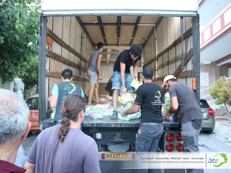 food baskets distribution for refugees in Athens