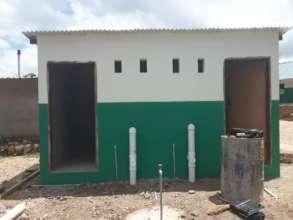 2 flush toilets' block