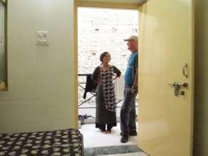 Basanti getting dropped off at her nursing hostel