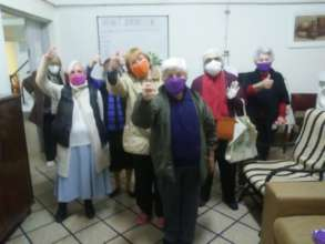 Many ladies receiving their face masks