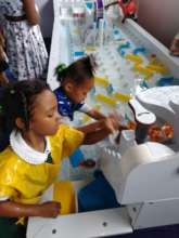 Students play with the Water Table on a Field Trip