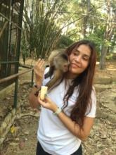 SAI Zoo Keeper Affectionately Feeds Adult Monkey