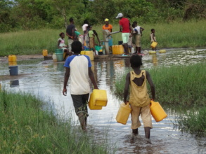 People walking on flooded roads to fetch water