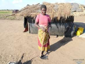 Woman with a provided farming tool