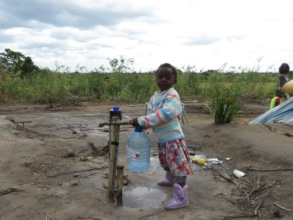 Child getting water two months after the cyclone