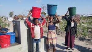 Children and ladies at a water supply point