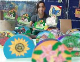 Painter with her creations