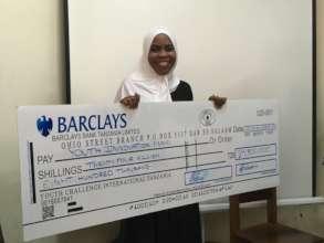 Our student, Ashrina, receiving a funding award