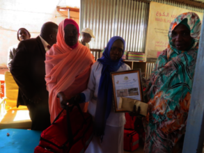 Munira Receiving her Certificate and Midwifery Kit