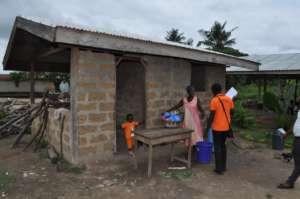 Community members serving Nadit's school