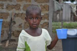 Nadit's classmate eating porridge served at school