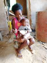 Akosua and her baby.