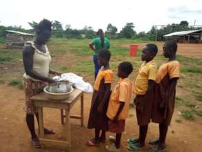 Charity sells rice at the school