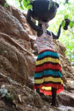 Zokotu woman ascending up the cave