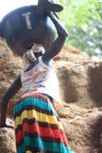 Zokotu woman struggling to ascend from cave