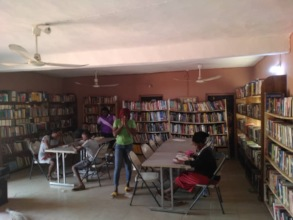 Children using the library at Ogidi Centre