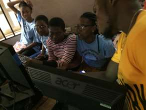 Maid Strong Girls Learning Computer Skills