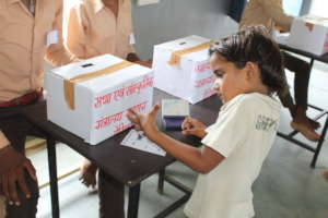 Student casting her vote for Child parliament