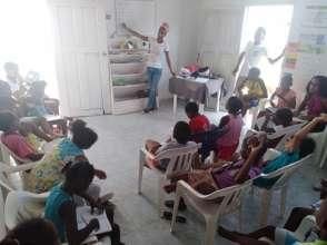 Genelle teaching to the kiddies in Marlinda