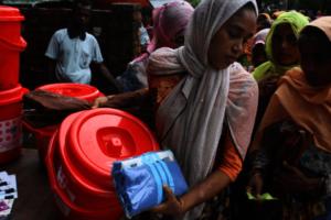 Woman receiving dignity kit.