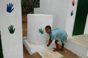 A student using the newly installed taps