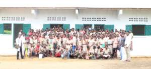 Students and teachers gather at new classrooms