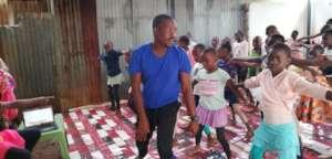 Our founder taking children through dance training