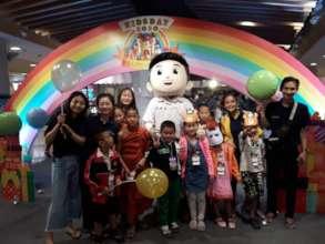BEAM volunteers with children on Children's Day