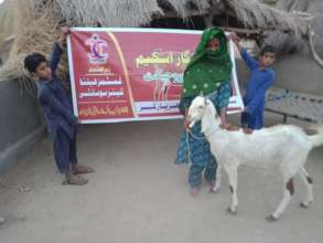 Children are happy to get a Goat