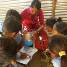 Gujarpa Basic School teacher and students
