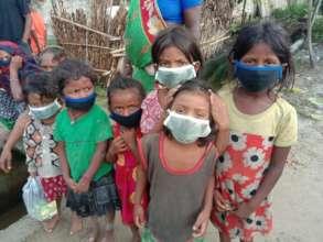Children in Ramdhuni sporting their new masks