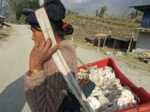 ETC women's group member taking mushrooms to sell