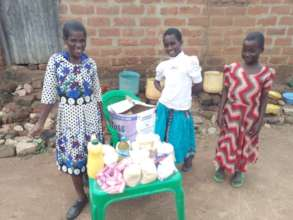 Josephine with her mum and sister & their supplies