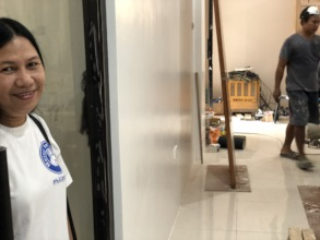 Midwife Cecille watches progress on birth center!