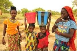 Fulani girls transporting water 1.5 miles.
