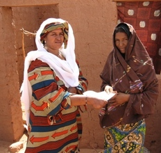 Mentor Tarbane receives letter from RAIN's Rabi (left)