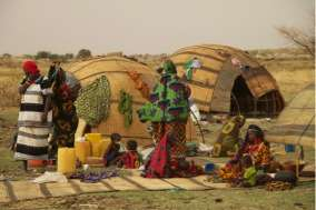 A nomadic Fulani camp with secco mat tents.