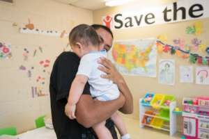 Baby and his father in a child friendly space