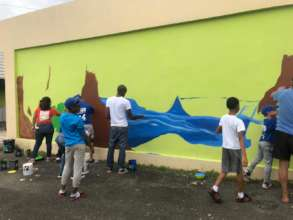 Community Members and Artist Painting Mural