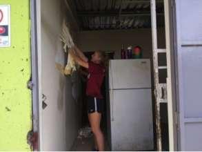 Volunteer preparing the Community Kitchen area