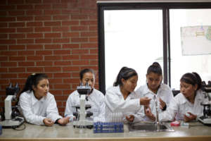 Girl Pioneers in Science Class Photo by Anna Watts