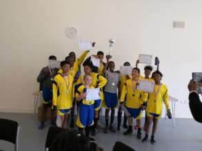 The Winning team receiving the Trophy
