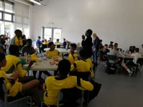 Team listening to the speech of our sport director