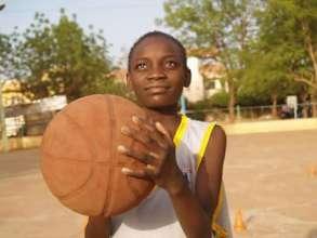 Awa playing basketball