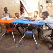 Children enjoying their new desks